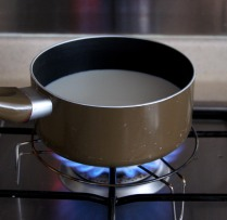 Heat the milk without boiling it