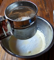 Sift the flour into the egg whites