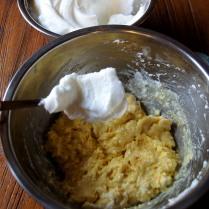 Fold 1 spoon of whites into yolks