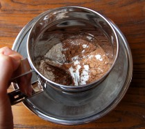 Place cocoa and flour in sifter