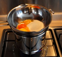 Egg yolks+sugar over hot water
