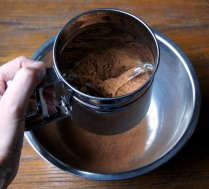 Sift cocoa powder into a bowl