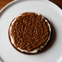 Top with a third of caramel icing