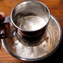 Sift dry ingredients through
