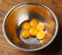 Add egg yolks to the bowl
