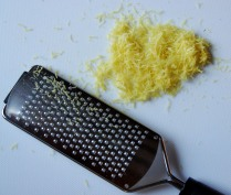 Grate the zest of both lemons