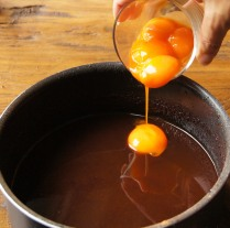 Add egg yolks