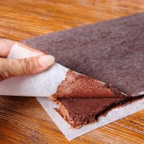 Turn cake onto sugared paper