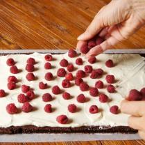 Sprinkle with raspberries