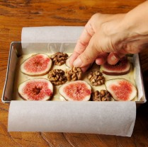 Top cake with walnut halves