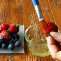 Brush berries with egg white