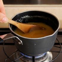 Stir over low heat til smooth