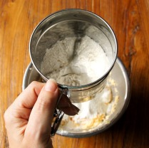Sift in flours, in 2 batches