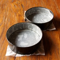 Grease and line cake pans