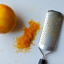Grate both oranges