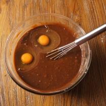 Whisk in eggs