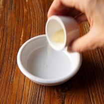 Sprinkle gelatine over water