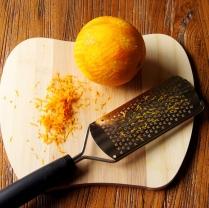 Grate the orange