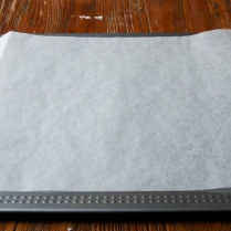 Cover baking sheet w/paper